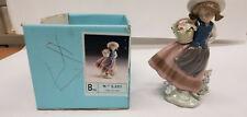 Lladro no. 5221 Linda con cesta (Sweet Scent) figurine