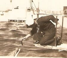 Vintage WWII Real Photo US SAILOR FEEDING DOLPHIN a Fish from Bow of Ship - Old