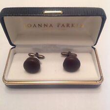 - brown leather joanna parkin round cufflinks
