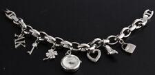 Anne Klein Women's Silver Tone Charm Bracelet Watch 10-7605CHRM
