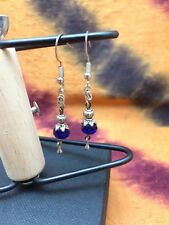 Earrings in silver wire with small tibetan stones, and blue crystals
