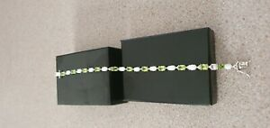 hallmarked 925 Peridot and Created White Opal Oval Tennis Bracelet