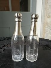 A Novelty Pair of Champagne Bottle Decanters