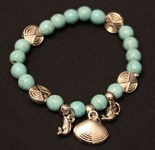 """Simulated Turquoise Stretch Bracelet with Silver Tone Dolphin/Shell Charms, 7""""+"""