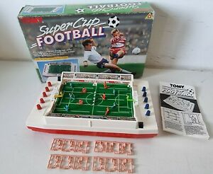 Tomy Super Cup Football Electronic Game 1980s  with spare players. Fully working