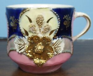 Highly Decorated Mustache Cup  Used