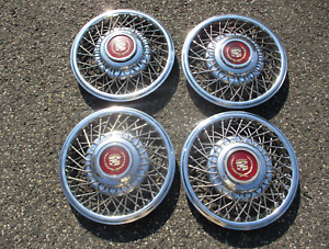 Factory 1985 to 1988 Cadillac 14 inch wire spoke hubcaps gold package nice