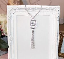 Flapper/1920's long silver necklace circle pendant with rhinestones and tassel
