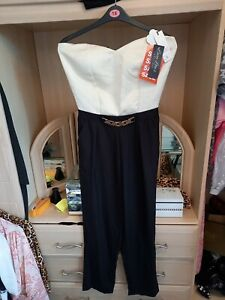 Jumpsuit L/12 NEW WITH TAGS.