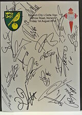 An A4 white card with the Norwich City Badge. Signed by 19 players on 01.08.2014