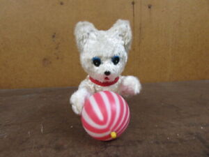 ANTIQUE WIND UP PLUSH TOY Arms move and ball spins white puppy dog Works fine