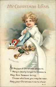 Ellen Clapsaddle Christmas - Boy Opens Stocking in Bed c1910 Postcard