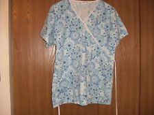 ladies size (M) sierra short sleeve shades of blue floral scrub top