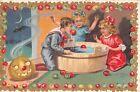 1909 Jack O Lantern & Children Bobbing for Apples Joys of Halloween post card
