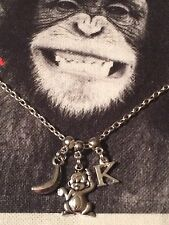 Personalised Tibetan Silver Cheeky Monkey And Banana And Initial Necklace