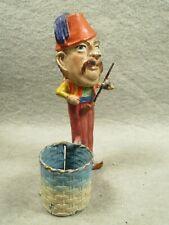 Heyde, man in a fez, smoking a pipe, vintage metal stamp holder