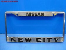 "VINTAGE "" NEW CITY "" NISSAN LICENSE PLATE FRAME OEM"