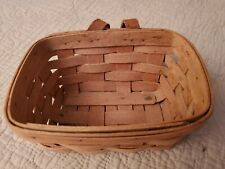 Small Longaberger basket hangs with leather handle; vintage 1988