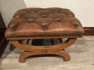 Footstool: antique leather topped on cherry wood base