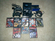 Play Station 2 with 8 games used very little