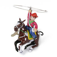 Vintage Wind Up Tin Toy Cowboy with Whip and Spinning Lasso