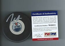 TAYLOR HALL SIGNED EDMONTON OILERS PUCK PSA/DNA W45911