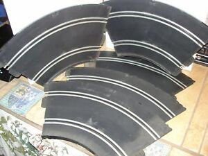 Lot of 5 Vintage Strombecker curved tracks offered by MTH