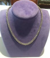 18K WHITE GOLD & GRADUATED DIAMOND TENNIS NECKLACE 18.00 CTS.