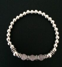 Sterling Silver Rose Quartz Gemstone And Tibetan Silver Bead Stretch Bracelet.