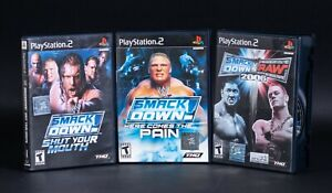 Lot of 3 PS2 WWE Smackdown vs Raw Games Here Comes the Pain 2006 CIB w/ Manuals
