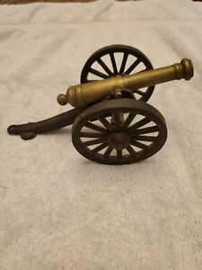 VINTAGE BRASS AND CAST IRON  CANNON WITH LARGE WORKING WHEELS