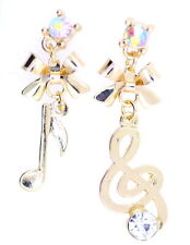 Gold tone mismatched musical note, bow and crystal dangle earrings