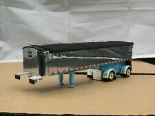 1/64 Dcp blue/white/chrome spread axle Mac dump trailer new no box
