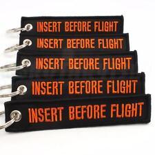 INSERT BEFORE FLIGHT KEYCHAIN BLACK/orange QTY =  5 TAGS CABIN CREW