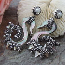 White Pearl Black Mother Of Pearl Trimmed with black macarstite Carved Earrings