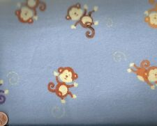 Jumping Monkeys jungle animals blue flannel fabric