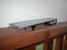 DCP 1/64 SILVER DECKED AND BLACK FRAMED WILSON ROADBRUTE FLAT BED TRAILER
