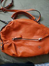 Large orange leather handbag