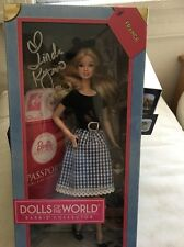 DOLLS OF THE WORLD FRANCE BARBIE DOLL PASSPORT SIGNED BY LINDA KYAW