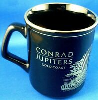NU CONRAD JUPITERS Gold Coast BLACK/GOLD Ceramic Mug C.R.HOSE CASINO COLLECTABLE