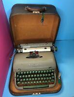 Vintage 1950's Remington Quiet-Riter typewriter with case