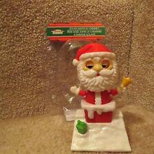 Solar Santa in a Chimney - Swinging Hands