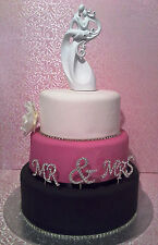 BRIDAL/WEDDING CAKE TOPPER/DECORATION - Groom Carrying/Holding His Bride