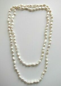 """36"""" - 46"""" Long 8/ 9 mm White Freshwater Cultured Baroque Pearl Necklace."""