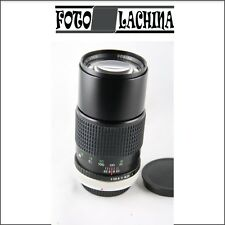 COSINA 200 mm  f 4  manuale   per CANON FD   AE1-A1-FTB-ecc..