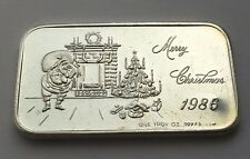 1986  MERRY CHRISTMAS SILVER .999 FINE ONE OUNCE BAR