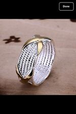 STERLING SLIVER ROPE BAND WITH GOLD TONE RING SIZE 7