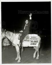 1957 Press Photo Frank Sinatra poses astride donkey, Irving, at theater.