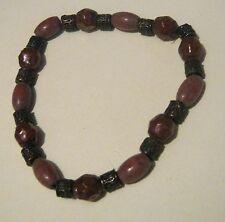Very pretty elasticated beaded bracelet with brown bronze tones