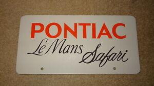 Vintage Pontiac Le Mans Safari dealer showroom license plate. 1980's. Script